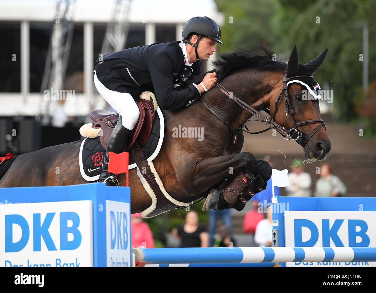 Berlin, Germany. 28th July, 2017. Show jumper Reiter Leopold van Asten in action on his horse Miss Untouchable during the AG-DVAG sponsored event at the Global Champions Tour in Berlin, Germany, 28 July 2017. This year's show jumping competition opened on the 28 July and will run through to the 30 July 2017. Photo: Britta Pedersen/dpa-Zentralbild/ZB/dpa/Alamy Live News - Stock Image