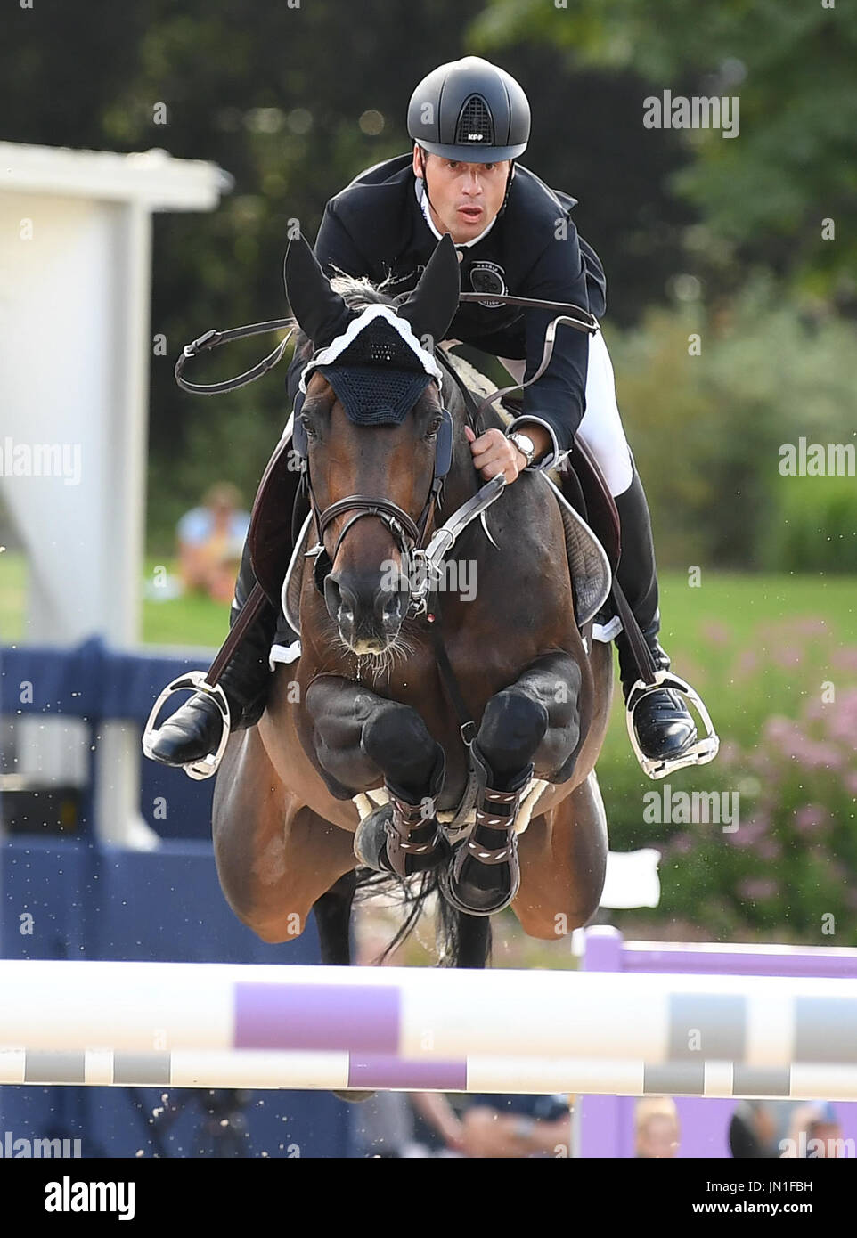 Berlin, Germany. 28th July, 2017. Show jumper Leopold van Asten in action on his horse Miss Untouchable during the AG-DVAG sponsored event at the Global Champions Tour in Berlin, Germany, 28 July 2017. This year's show jumping competition opened on the 28 July and will run through to the 30 July 2017. Photo: Britta Pedersen/dpa-Zentralbild/ZB/dpa/Alamy Live News - Stock Image