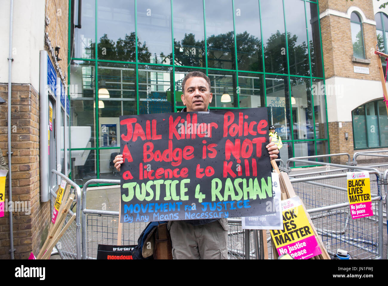 Stoke Newington, London. 29th July 2017. Protest took place at Stoke Newington police station over the death of Rashan Charles. Charles, 20, died after being apprehended by police in the early hours of July 22. Michael Tubi / Alamy Live News. - Stock Image