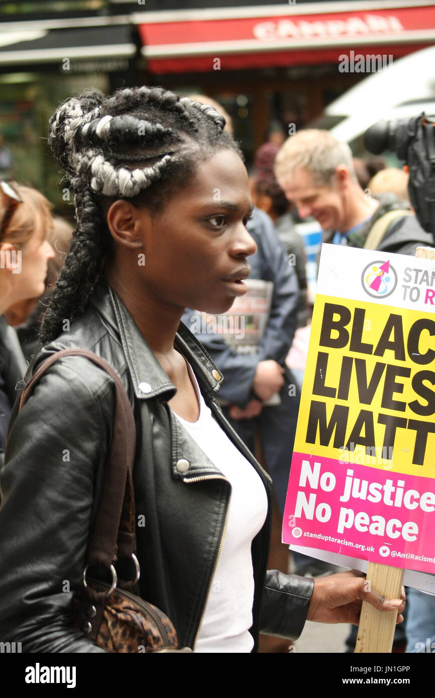 London, UK. 29th July, 2017. A protester holds a Black Live Matter placard, outside Stoke Newington police station. Called by Stand Up to Racism the protest focused on the recent death of Rashan Charles, after he was tackled by a police officer, and the death of Edson De Costa who also died following contact with the police a month ago. Roland Ravenhill/ Alamy Live News - Stock Image