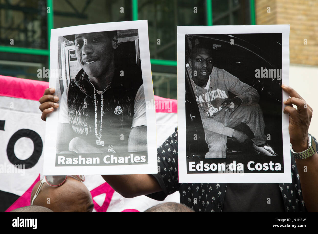 London, UK. 29th July, 2017. A protester holds up printed photographs of Edir (Edson) Da Costa (R), a 25-year-old - Stock Image