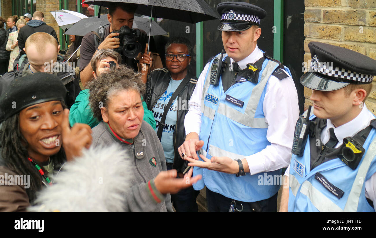 London, UK. 29th Jul, 2017. Protesters argue with police. Protest and vigil for Rashan Charles outside Stoke Newington police station who died after being chased and arrested by police. Penelope Barritt/Alamy Live News - Stock Image