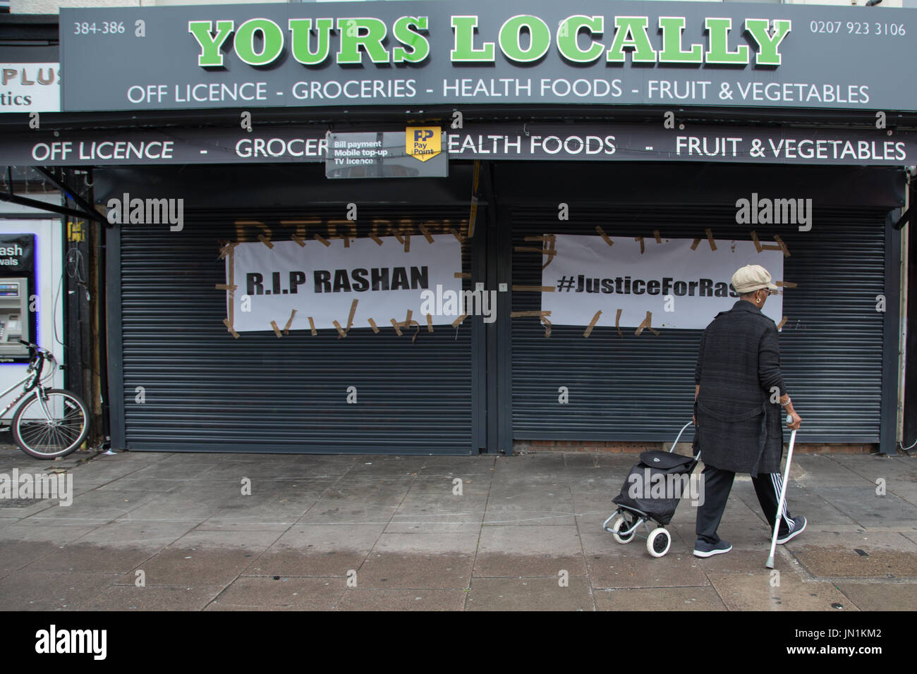London, UK. 29th July, 2017. A woman walks outside the Yours Locally shop in Kingsland Road where Rashan Charles was arrested in Dalston, east London. Credit: Thabo Jaiyesimi/Alamy Live News - Stock Image