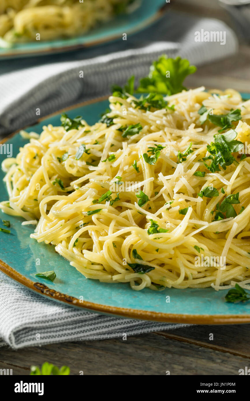 Garlic and Parsley Agnel Hair Pasta with Cheese - Stock Image