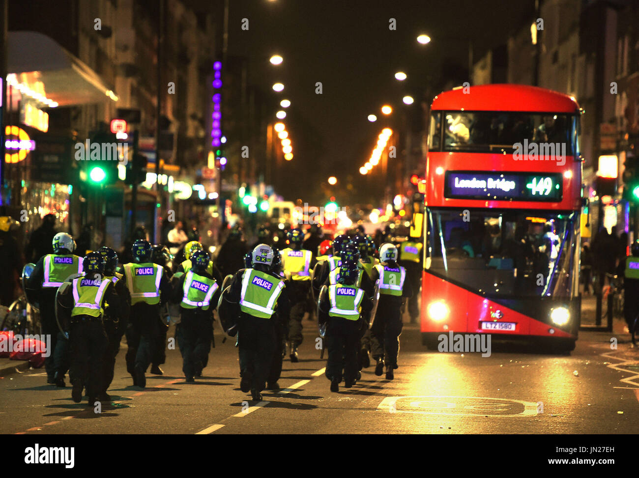 Riot police at a protest in Kingsland Road in east London, where people gathered in response to the death of Rashan Charles. - Stock Image