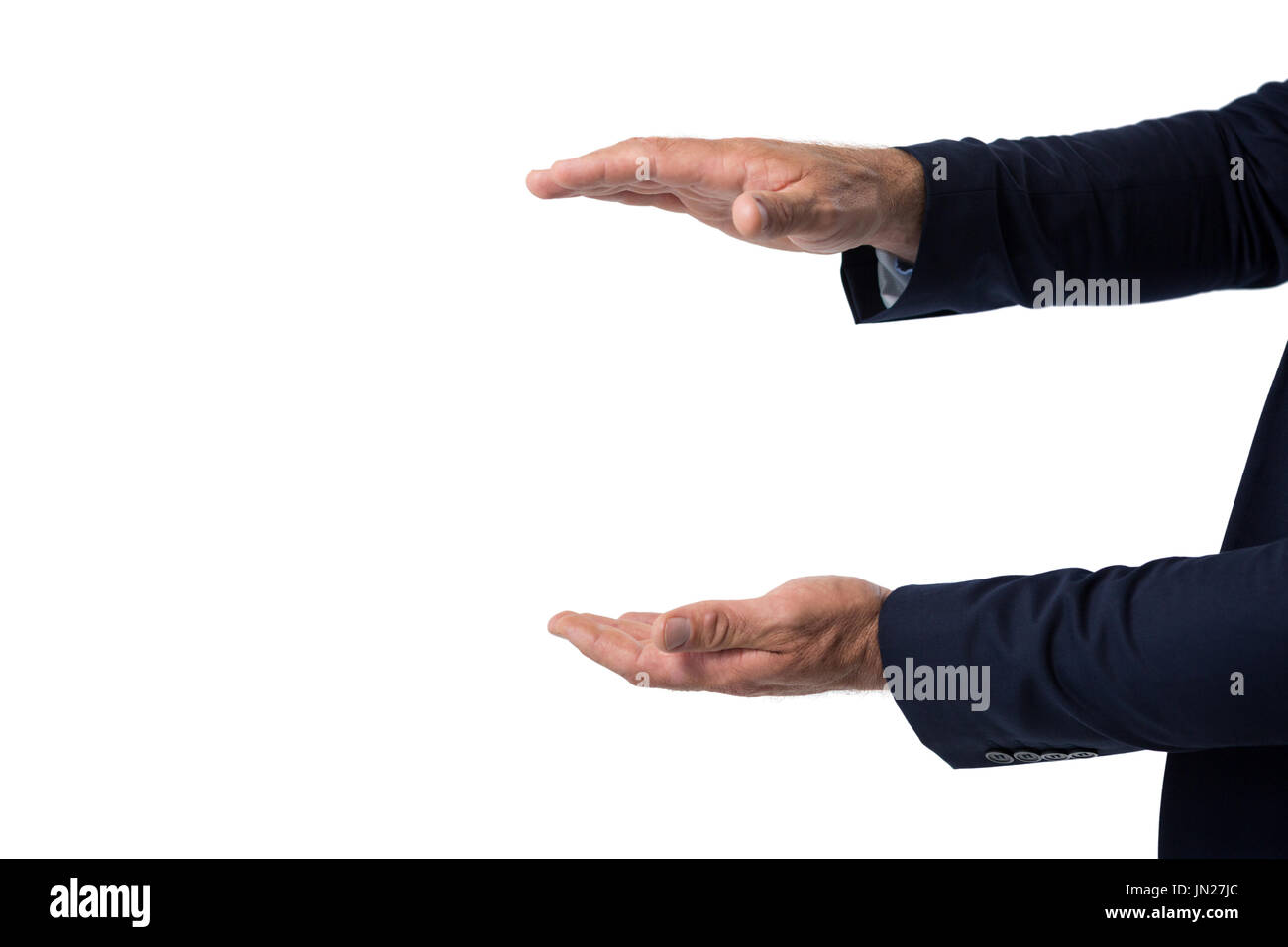 Businessman pretending to hold something against white background - Stock Image