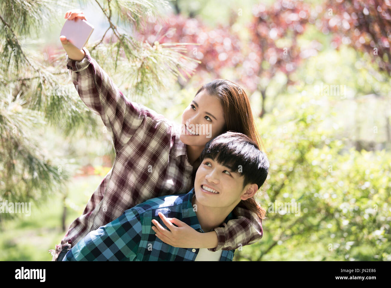 Young couple taking self portrait with mobile phone Stock Photo