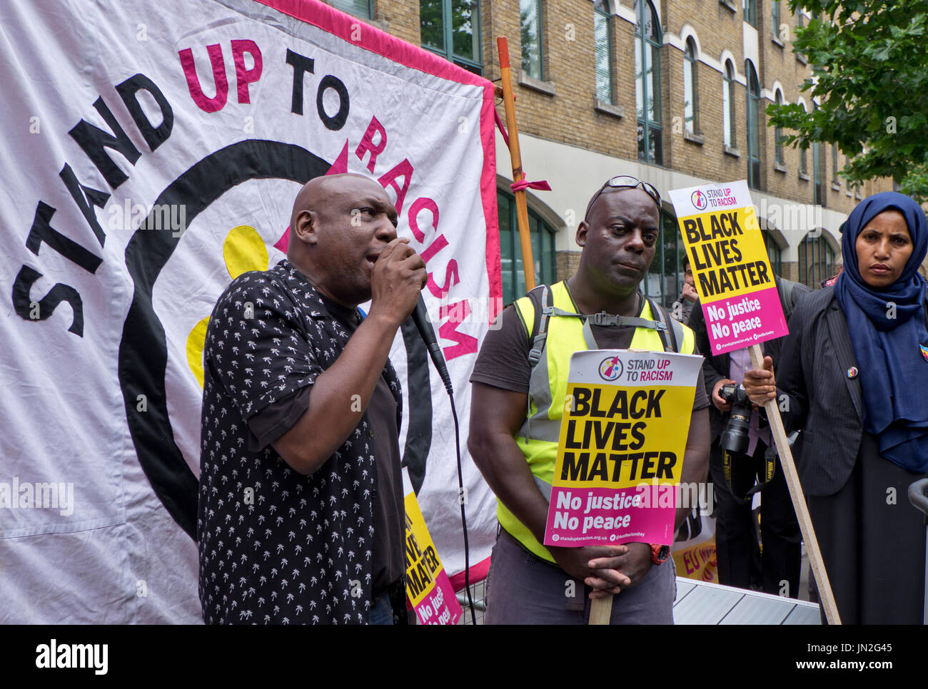 Black Lives Matter and local people demonstrate outside Stoke Newington Police Station for Rashan Charles, a 20-year-old black man who died after being apprehended by police in east London - Stock Image