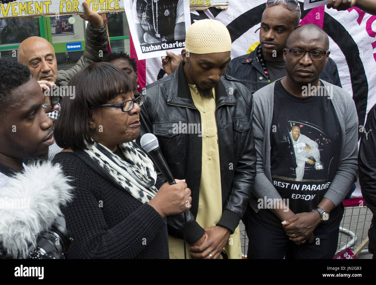 Diane Abbott, Ginario Da Costa (right), the father of Edson Da Costa, and Esa Charles, father of Rashan Charles - Stock Image