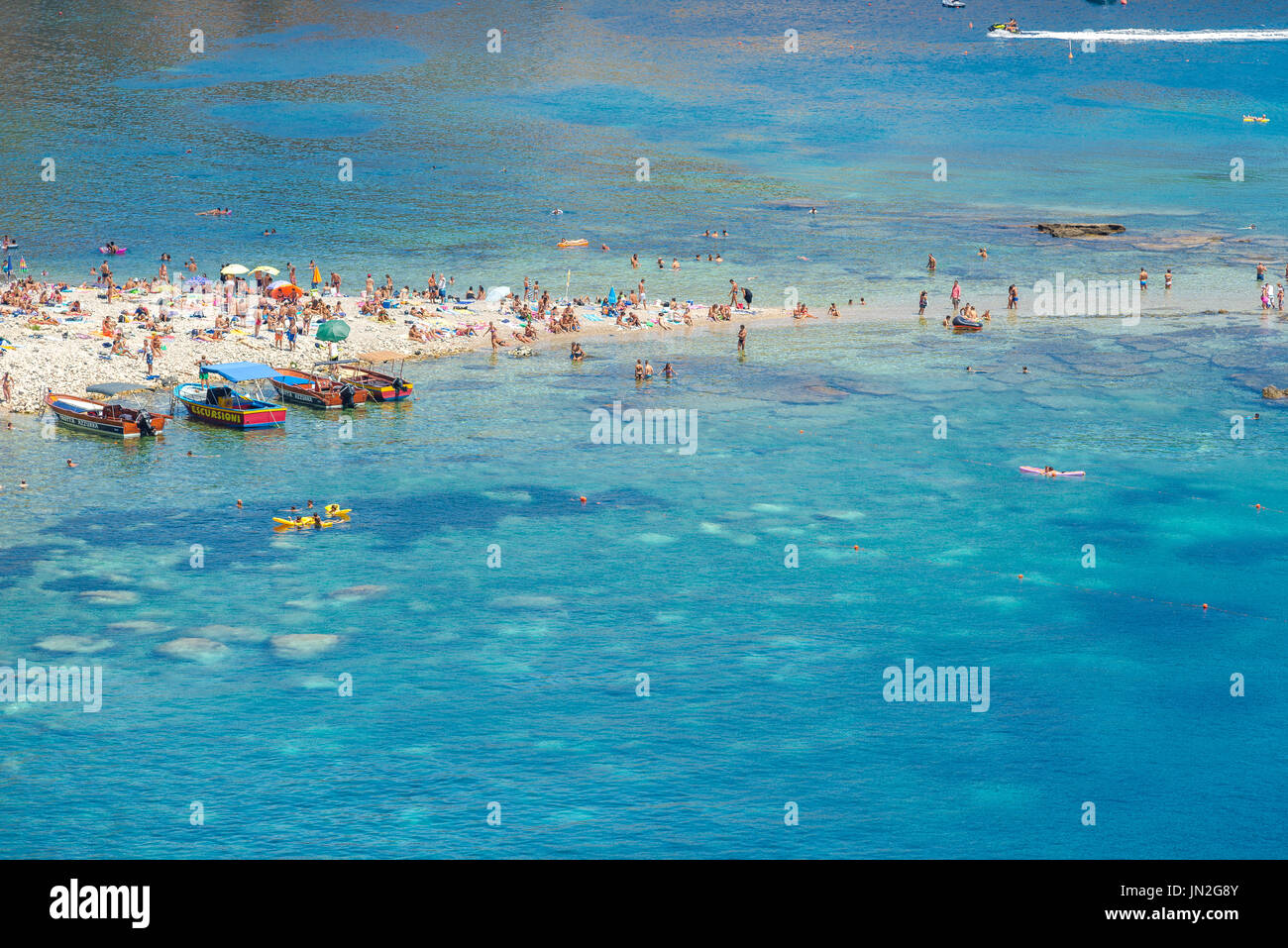 Mazzaro beach Sicily, close to Taormina the beach at Mazzaro is a popular location in summer for those keen to sunbathe - Stock Image