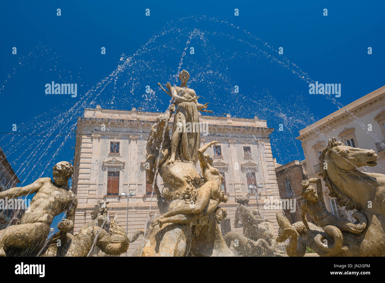 Sicily Baroque fountain, the Fountain of Artemis in the Piazza Archimede in Ortigia,Syracuse,Sicily. - Stock Image