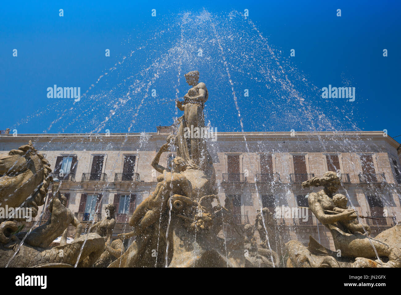 Syracuse Sicily fountain, the famous Fountain of Artemis in the Piazza Archimede in Ortigia,Syracuse,Sicily. - Stock Image