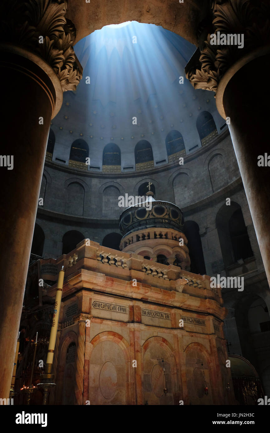 Ray of sunlight breaks through the ceiling over the Edicule, the shrine that tradition says houses the cave where Stock Photo