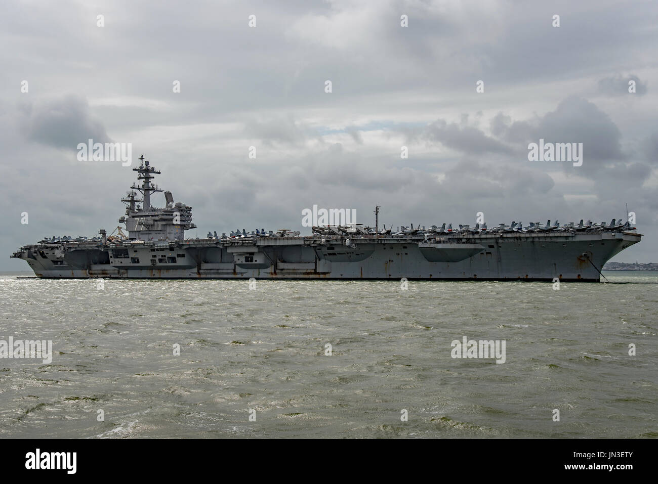 US Navy nuclear powered warship, the aircraft carrier USS George H W Bush on a visit to Portsmouth, UK by the United States Navy on 28/7/17. - Stock Image