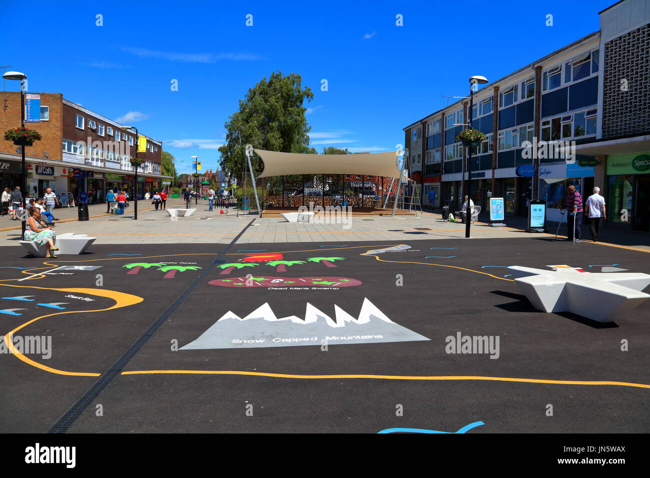 The new play area with its new protected stage area in the middle of the shopping center in Woodley town on a clear sunny day. - Stock Image