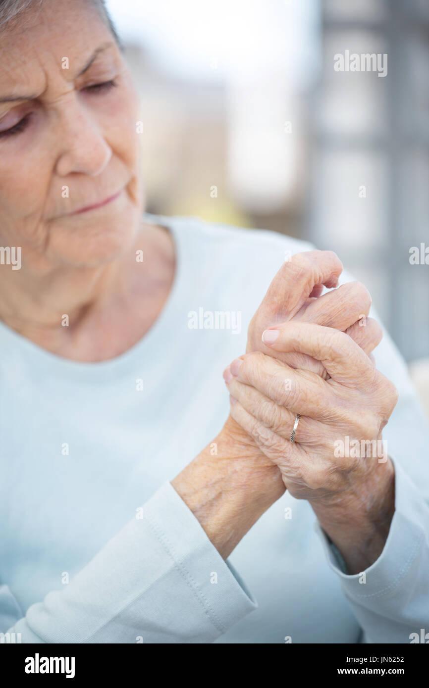 Elderly woman with arthritis. - Stock Image
