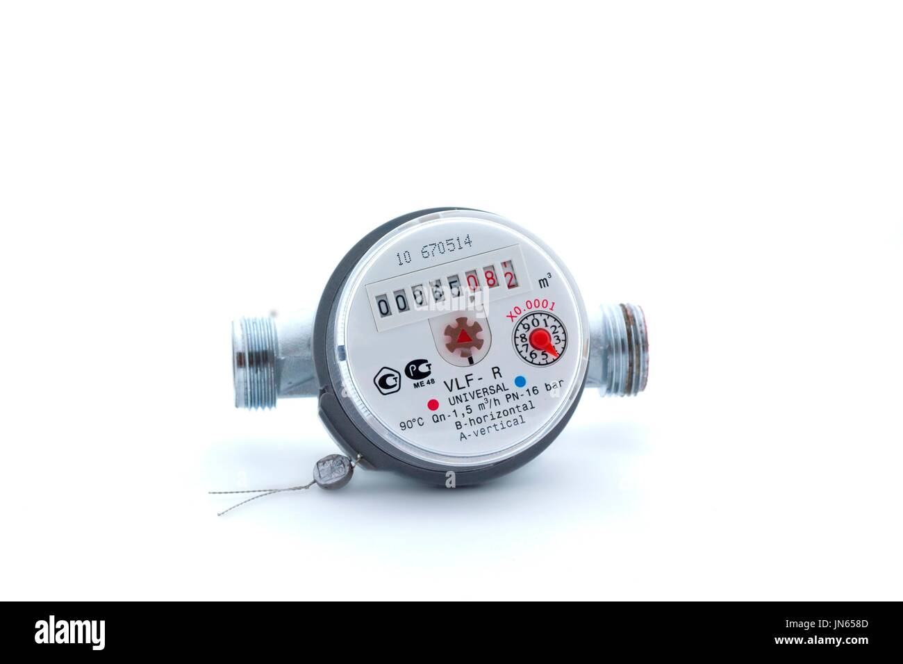 Used water meter isolated on white background - Stock Image