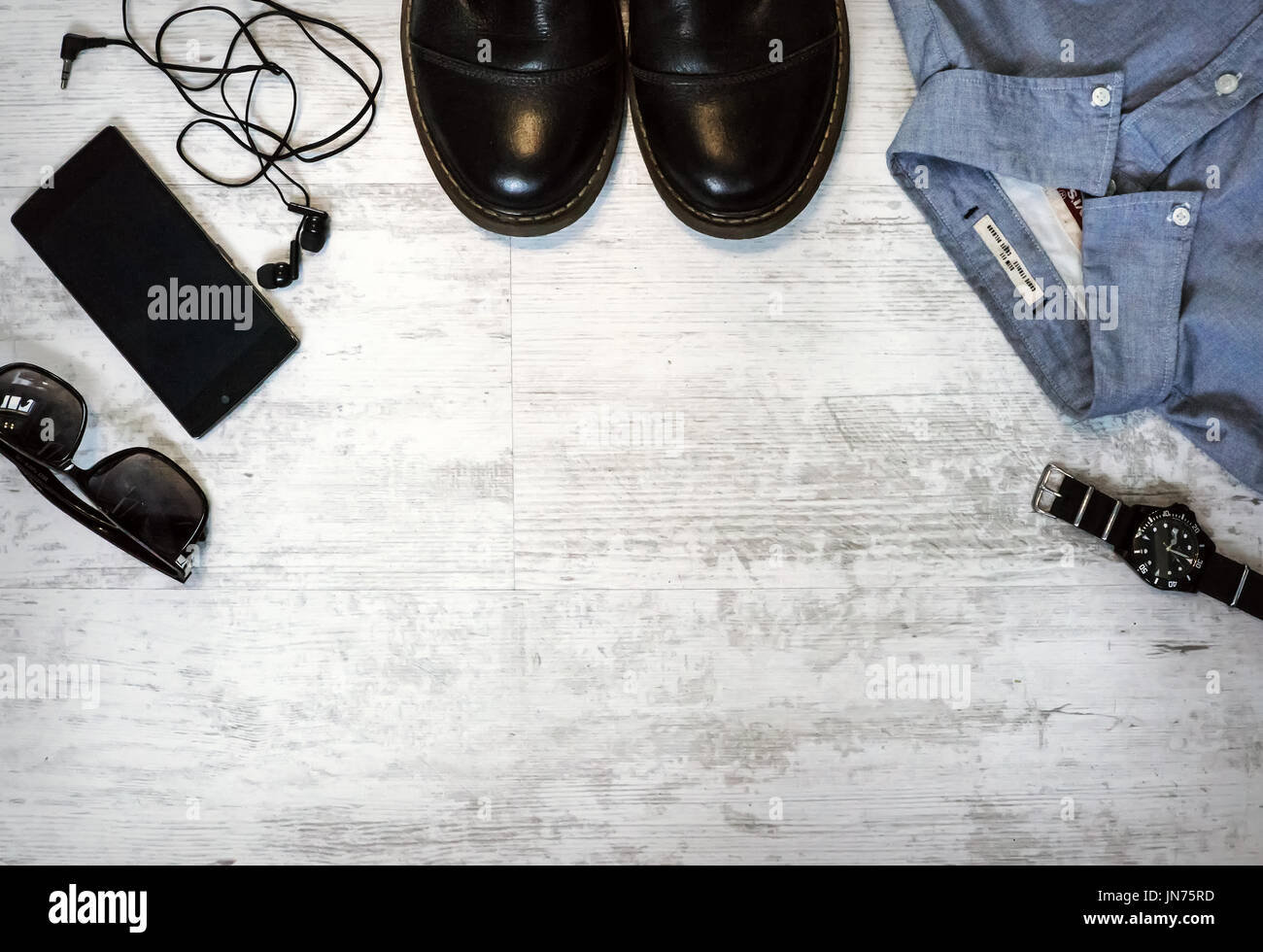 Men's casual outfits with accessories on on wood background with vitage color still life Stock Photo
