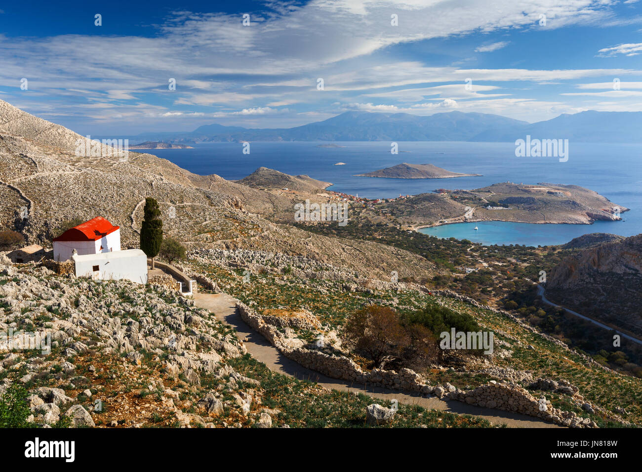 Church on a hilside on Halki island in Dodecanese archipelago, Greece. - Stock Image