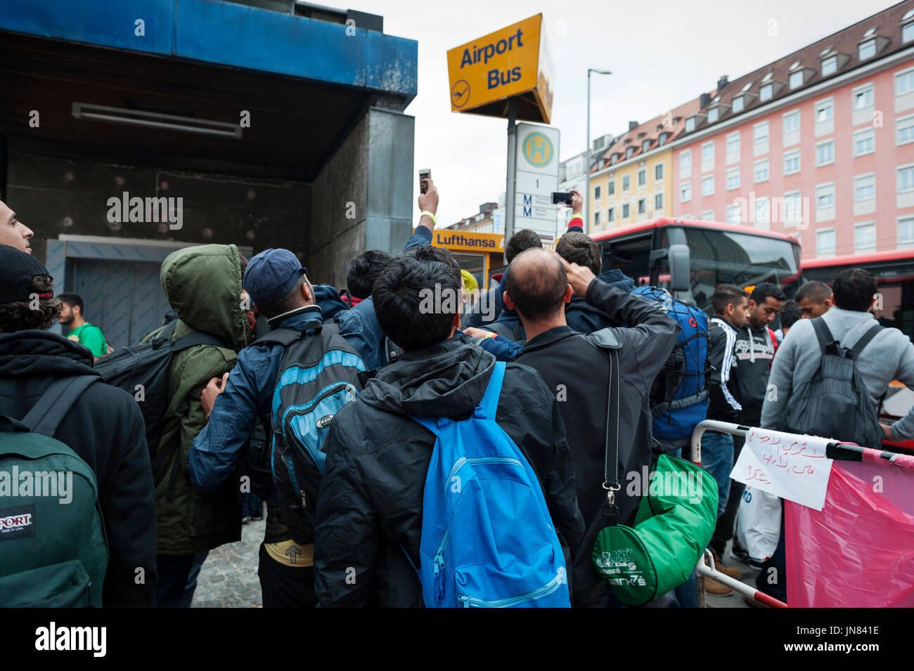 Munich, Germany -September 7th, 2015: A group of refugees from Syria at the Munich Central Station. They are seeking Stock Photo