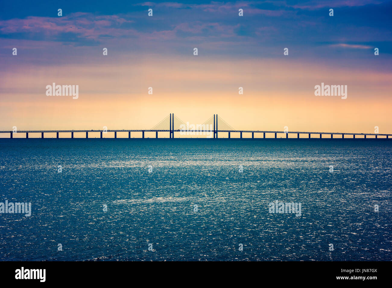 Oresund Bridge crossing the Oresund Strait, connecting Copenhagen Denmark and Malmo Sweden - Stock Image