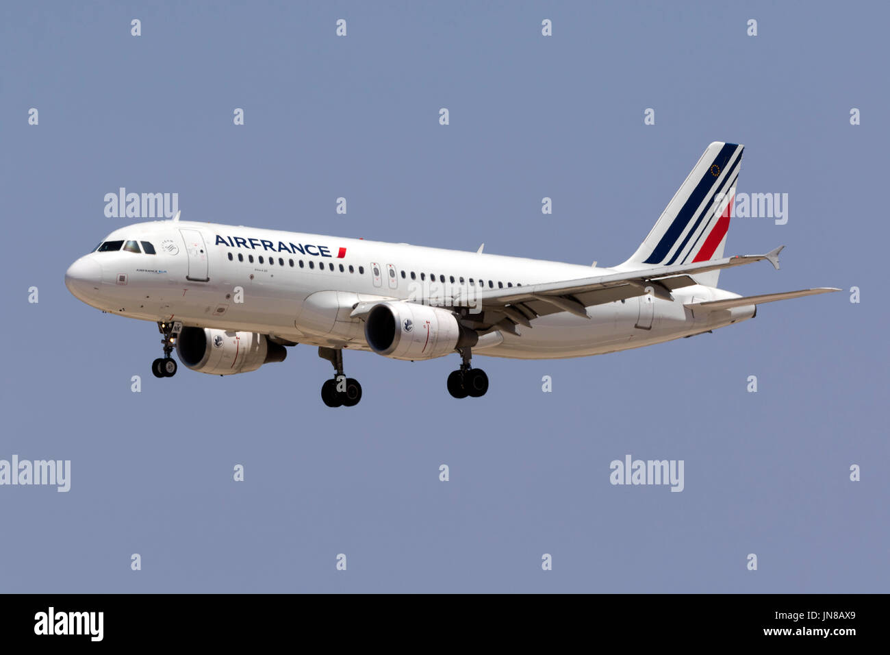 Air France Airbus A320-214 [F-HBNK] landing runway 31 in the afternoon. - Stock Image
