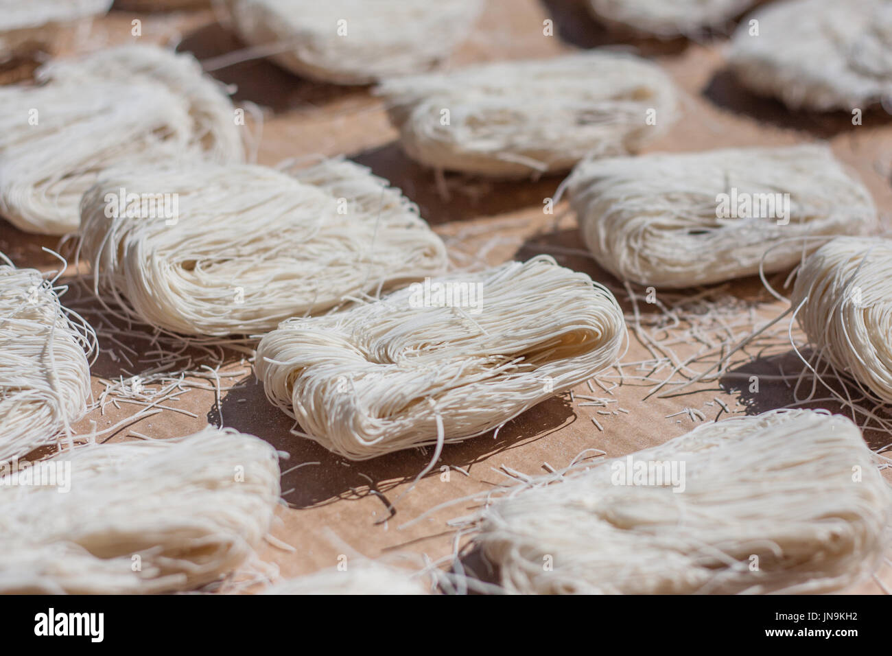 closeup of dry noodles drying in the sun - Stock Image