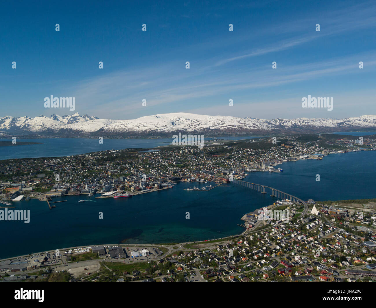 Looking down on Tromso City from Fjellstua viewpoint  panoramic view of the archipelago beautiful historic  town centre and the amazing Sunnmøre Alps  - Stock Image