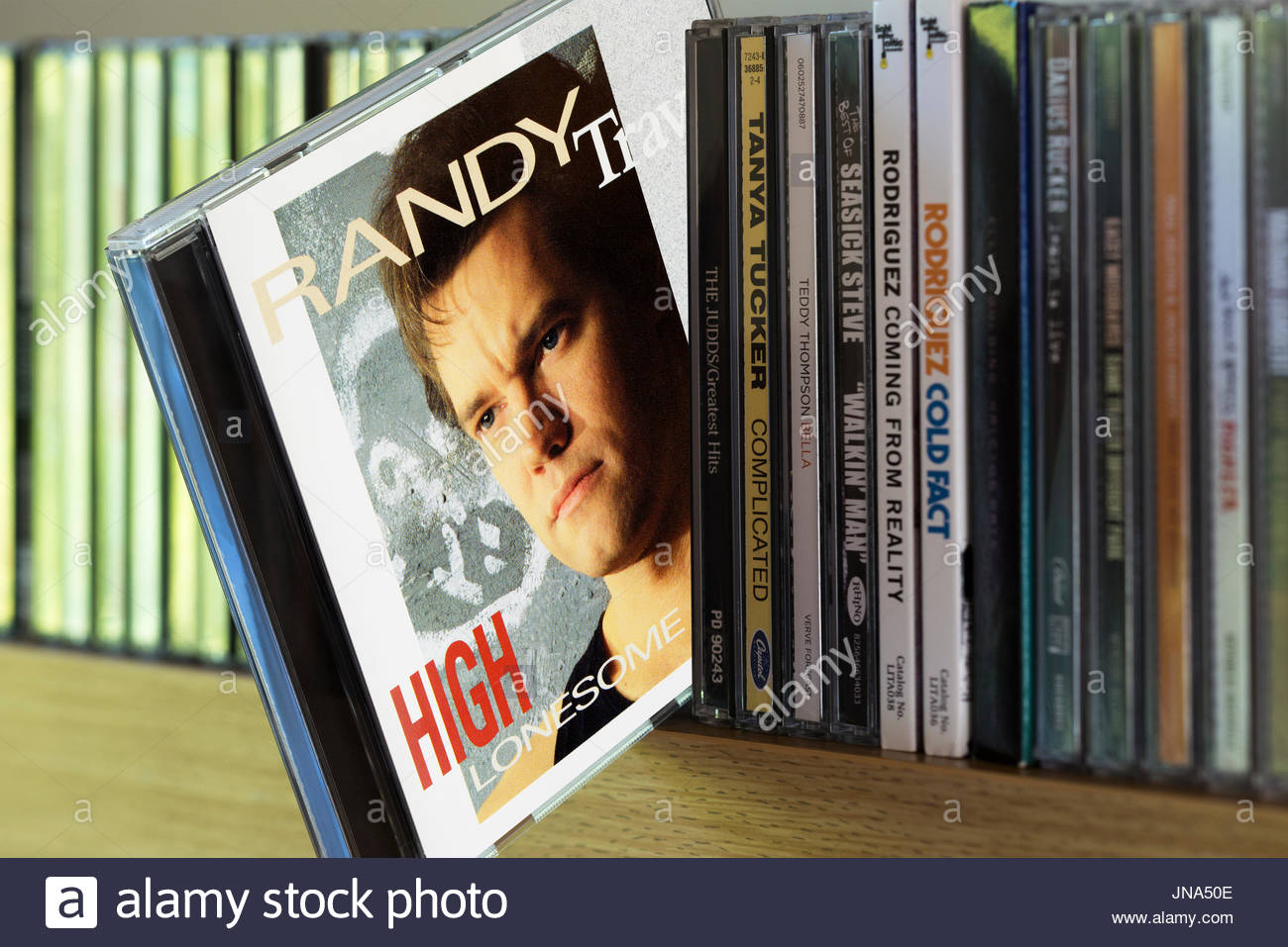 High Lonesome, Randy Travis CD pulled out from among other CD's on a shelf, Dorset, England Stock Photo