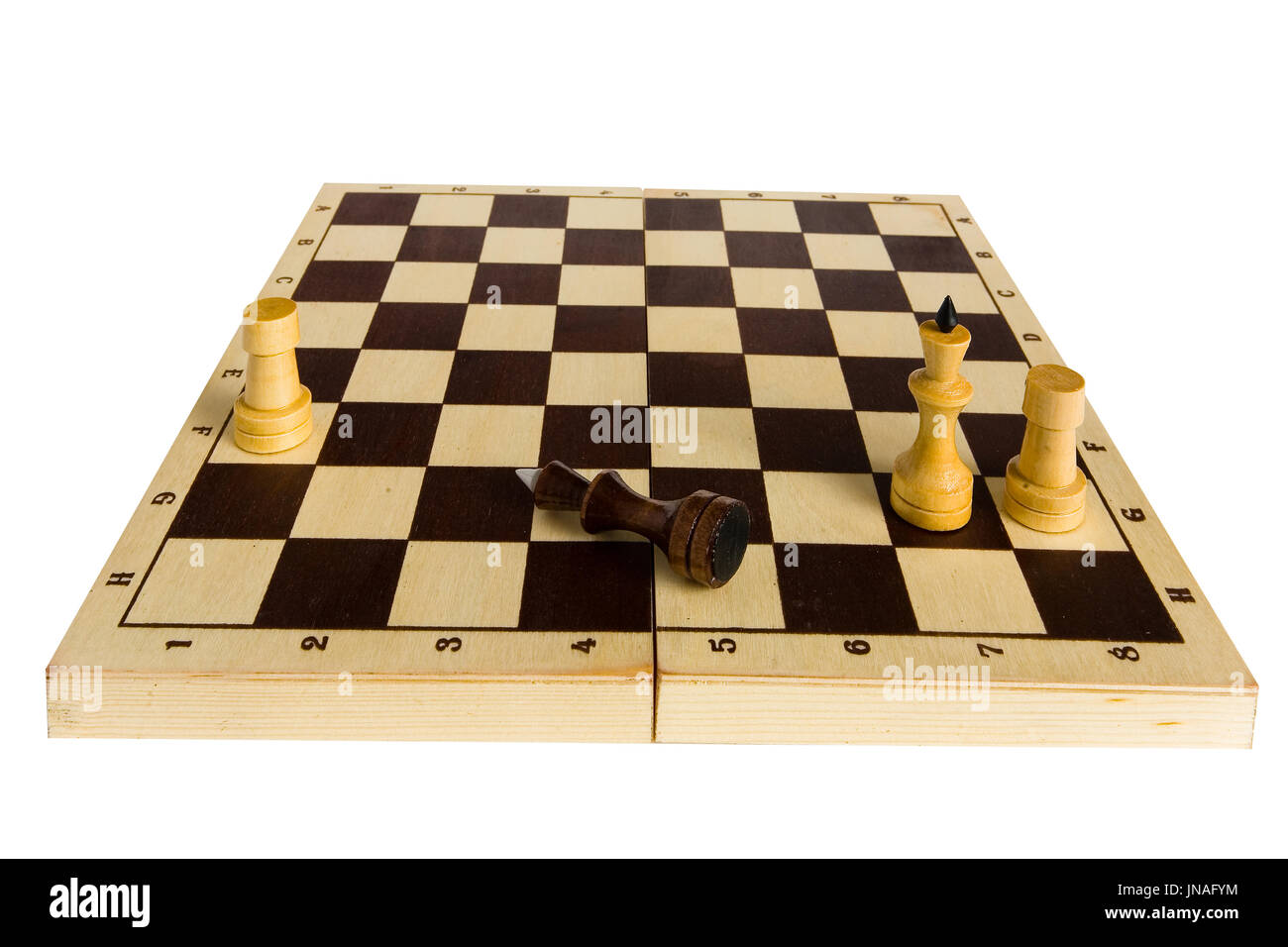 Endgame. The black chess king is defeated and lies on the board. - Stock Image