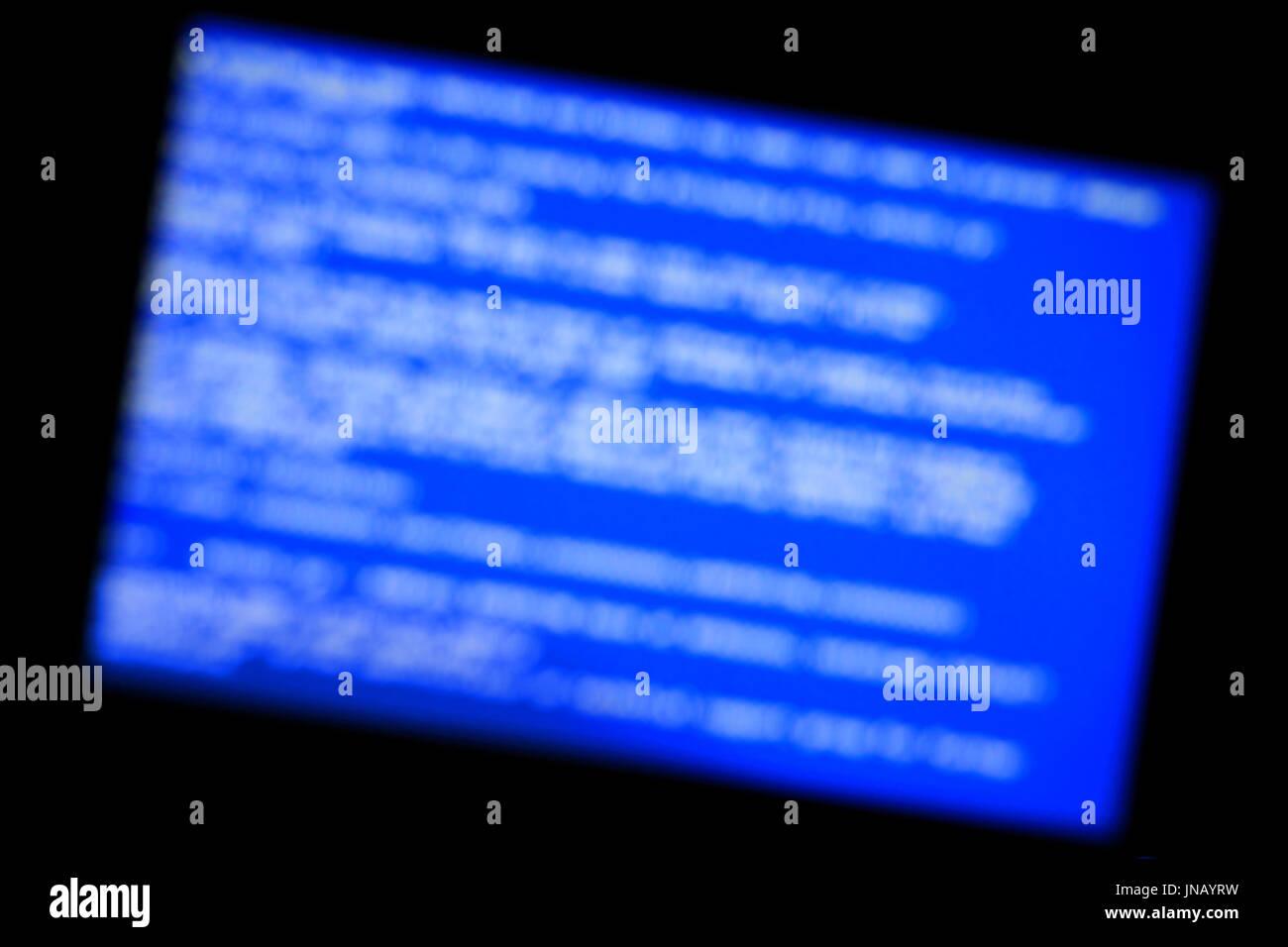 Blue screen of system crash. Defocused background - Stock Image