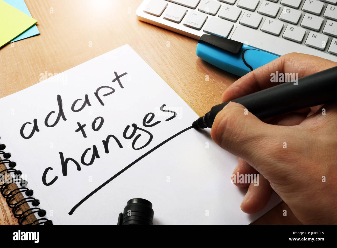 Adapt to changes written in a note. - Stock Image