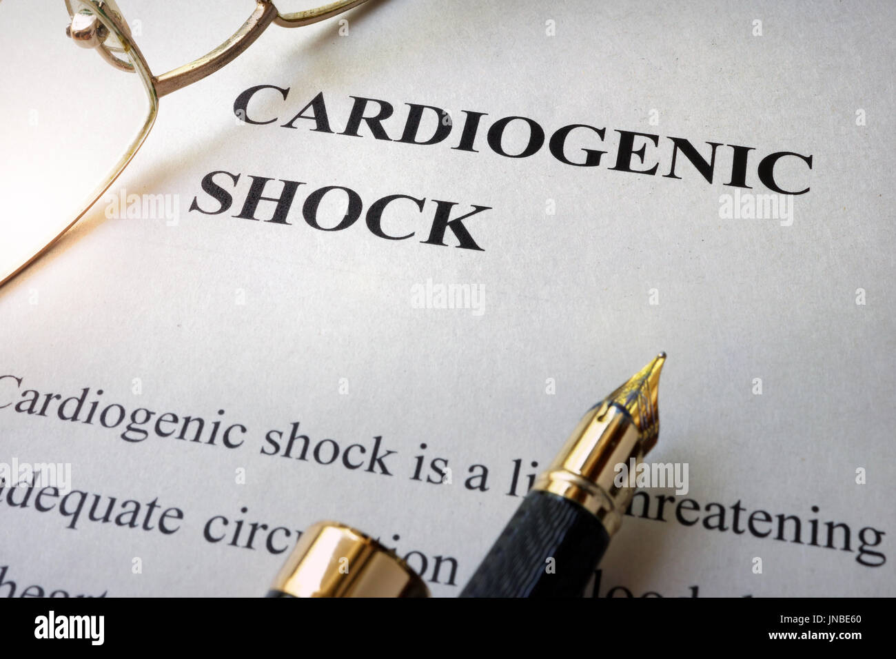 Paper with word cardiogenic shock and glasses. - Stock Image