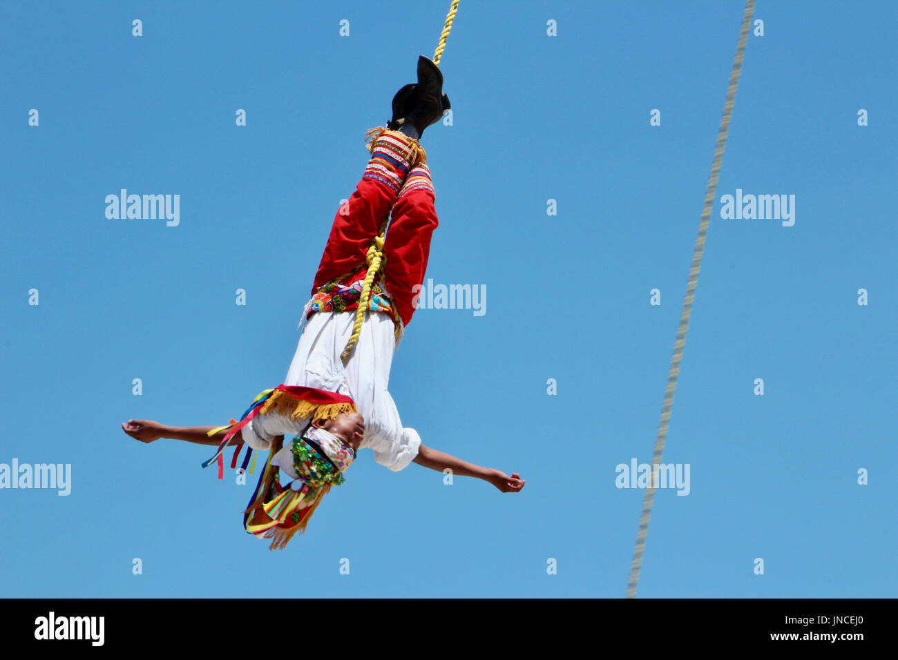 Papantla flyer performing the dance ritual in Mexico - Stock Image