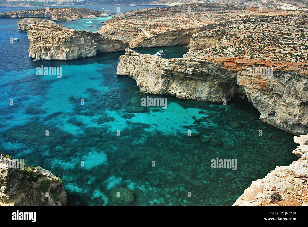 Looking towards Gozo from cliffs on the island of Comino, Malta - Stock Image