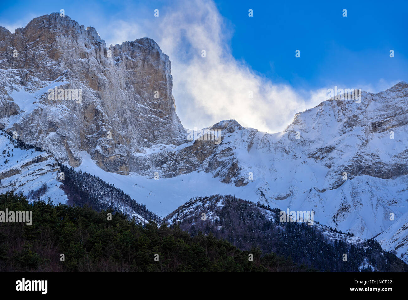 Faraut mountain peaks (Breche de Faraut and Pic de Chabournasse) in Champsaur covered in fresh snow in winter. Hautes Alpes, PACA Region, Southern Fre - Stock Image