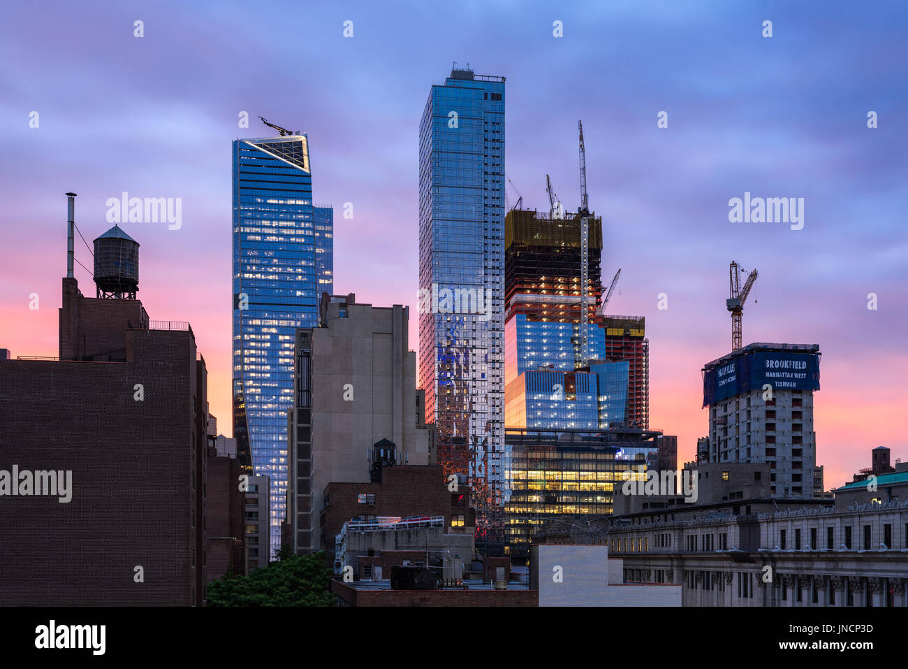 The Hudson Yards construction site (2017) and The Eugene skyscrapers at sunset. Midtown, Manhattan, New York City Stock Photo
