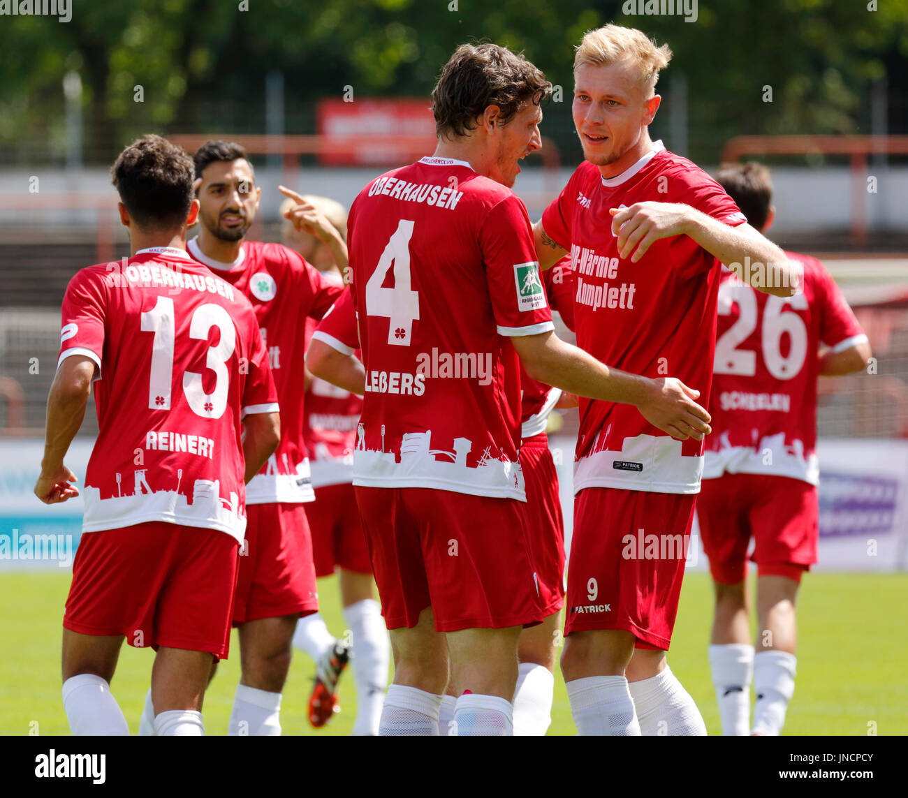 sports,football,Regional League West,2017/2018,Rot Weiss Oberhausen vs SV Westfalia Rhynern 2:1,Stadium Niederrhein in Oberhausen,rejoicing at the 2:1 winning goal,f.l.t.r. Dominik Reinert (RWO),Rafael Garcia (RWO),Robert Flessers (RWO),goal scorer Philipp Goedde (RWO) - Stock Image