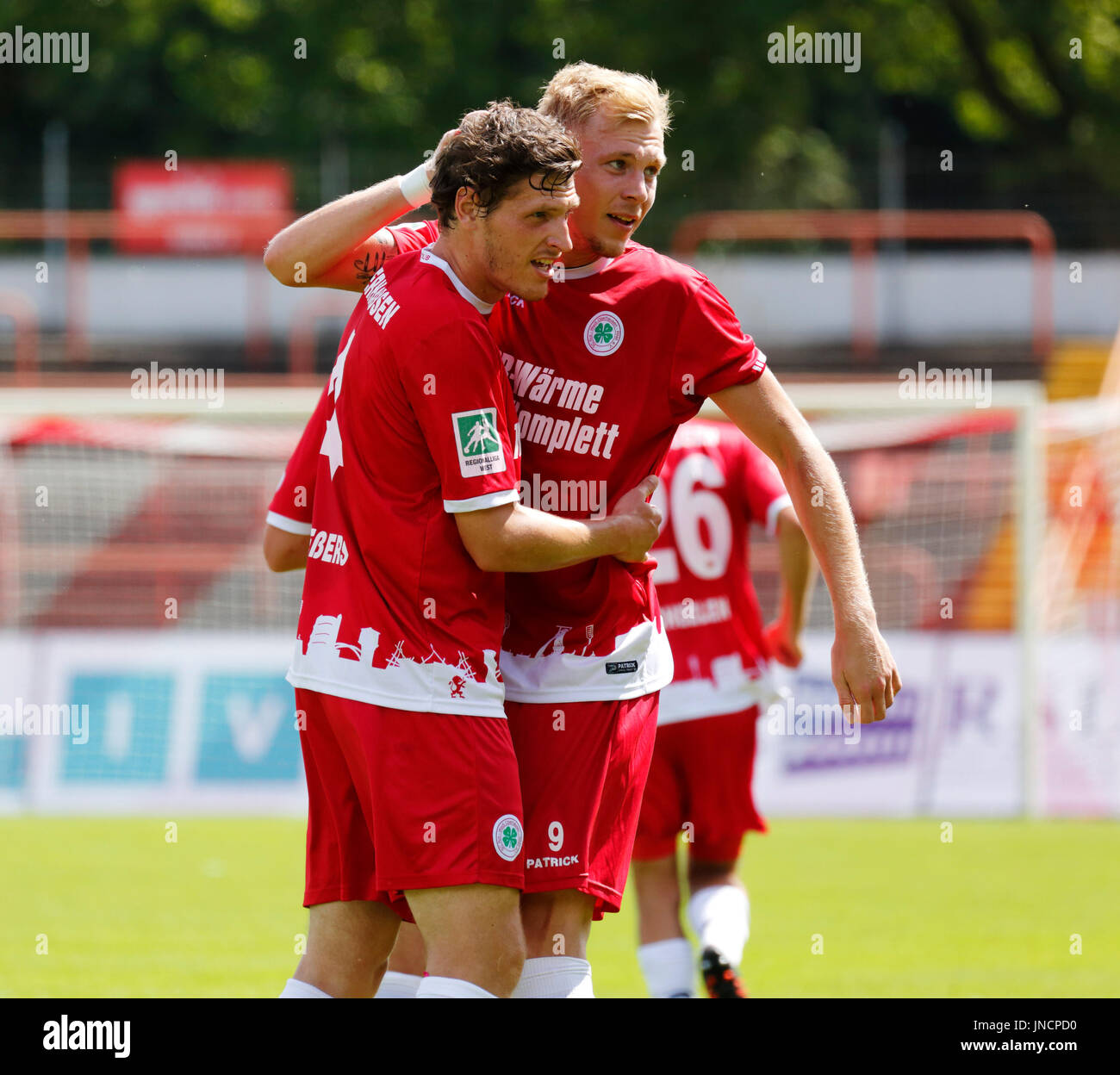 sports,football,Regional League West,2017/2018,Rot Weiss Oberhausen vs SV Westfalia Rhynern 2:1,Stadium Niederrhein in Oberhausen,rejoicing at the 2:1 winning goal,Robert Flessers (RWO) left and goal scorer Philipp Goedde (RWO) - Stock Image