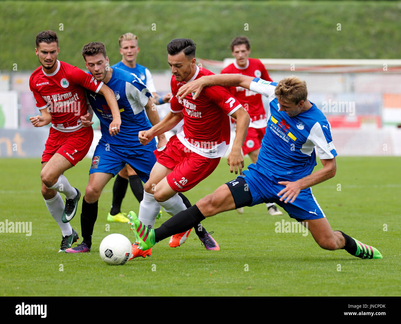 sports,football,Regional League West,2017/2018,Rot Weiss Oberhausen vs SV Westfalia Rhynern 2:1,Stadium Niederrhein in Oberhausen,scene of the match,f.l.t.r. Enes Topal (RWO),Jan Kleine (Rhynern),Nils Hoenicke (Rhynern),Tarik Kurt (RWO),Robert Flessers (RWO),sliding tackle by Patrick Polk (Rhynern) - Stock Image