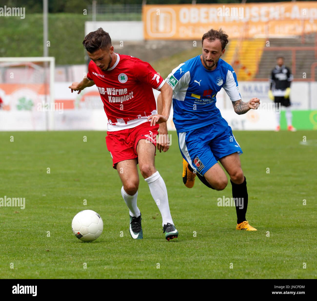 sports,football,Regional League West,2017/2018,Rot Weiss Oberhausen vs SV Westfalia Rhynern 2:1,Stadium Niederrhein in Oberhausen,scene of the match,Enes Topal (RWO) left and Sven Ricke (Rhynern) - Stock Image