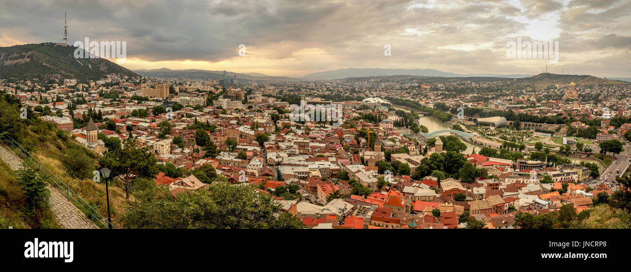 Panoramic view of Tbilisi, the capital of Georgia with old town and modern architecture during sunset. Stock Photo