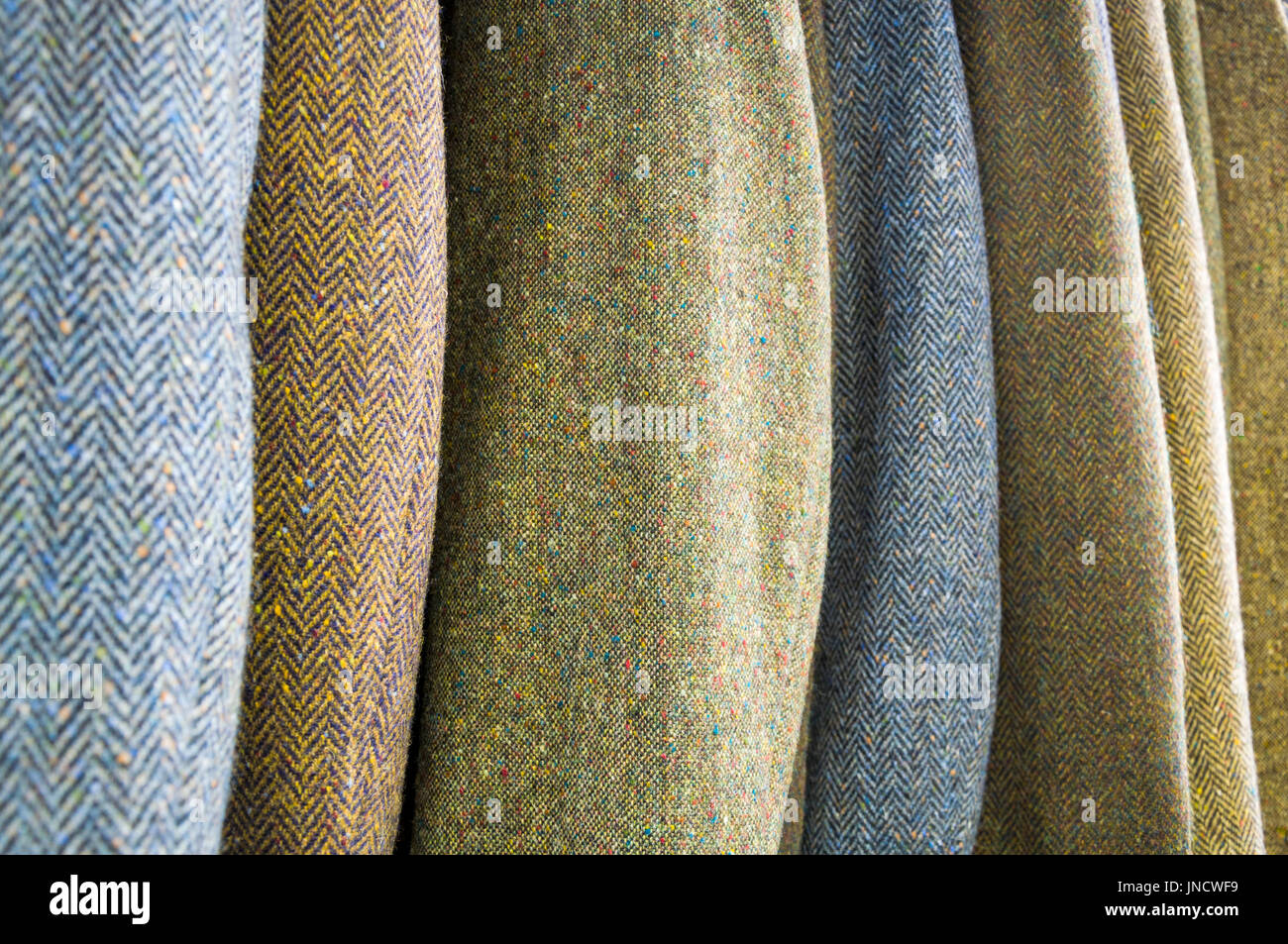 Hand woven Donegal tweed jackets showing the subtle colours of traditionally hand weaving tweeds. Ardara, County Donegal, Ireland - Stock Image