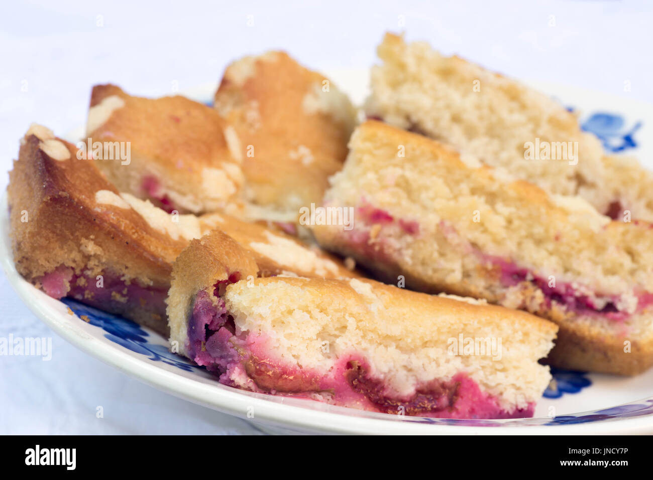 yeast cake with plums on plate - Stock Image