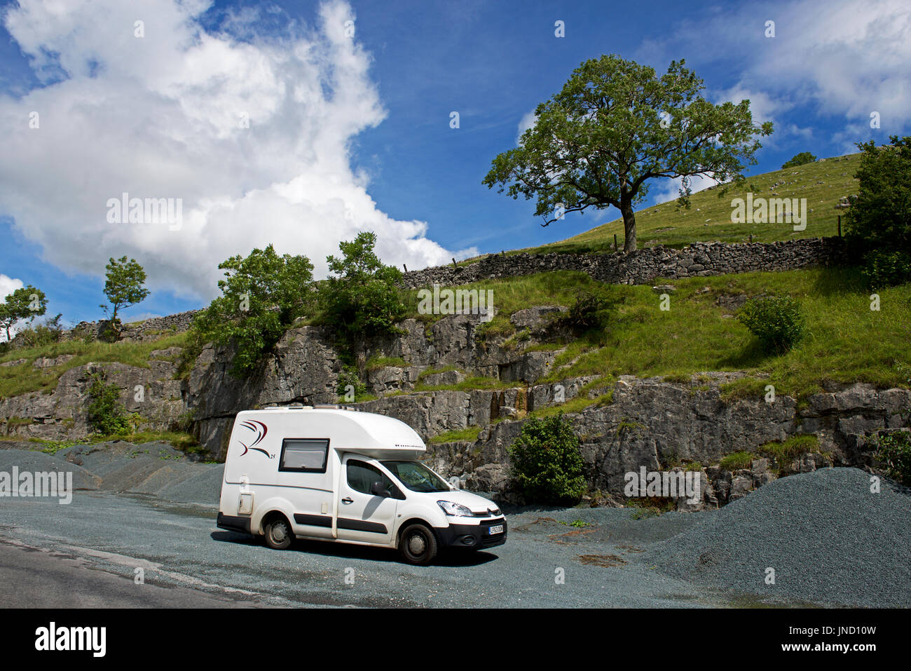 Romahome 25, small motorhome, parked in lay-by, Yorkshire Dales National Park, North Yorkshire, England UK - Stock Image