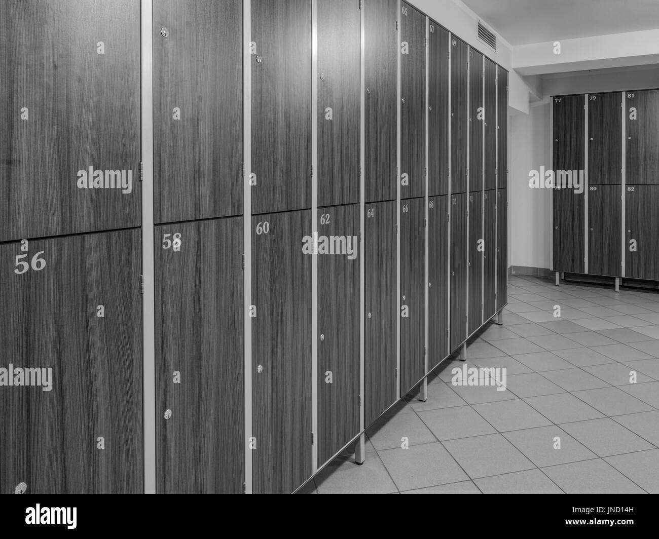 The row of wooden cabinets  in a fitness club dressing room - Stock Image