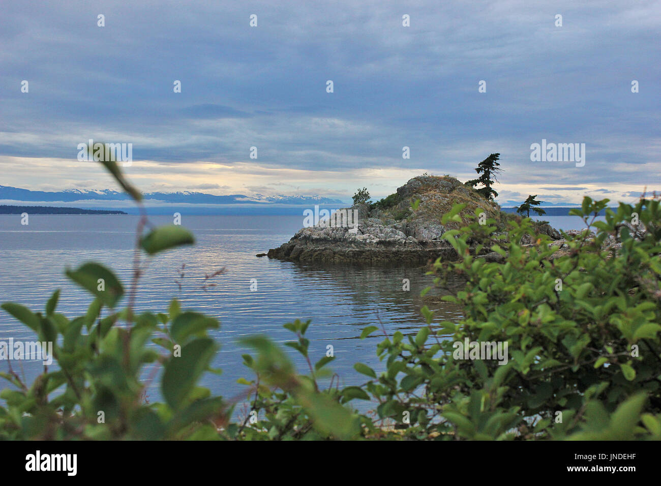 Sunset over Vancouver Island from Lund on British Columbia's remote Sunshine Coast - Stock Image