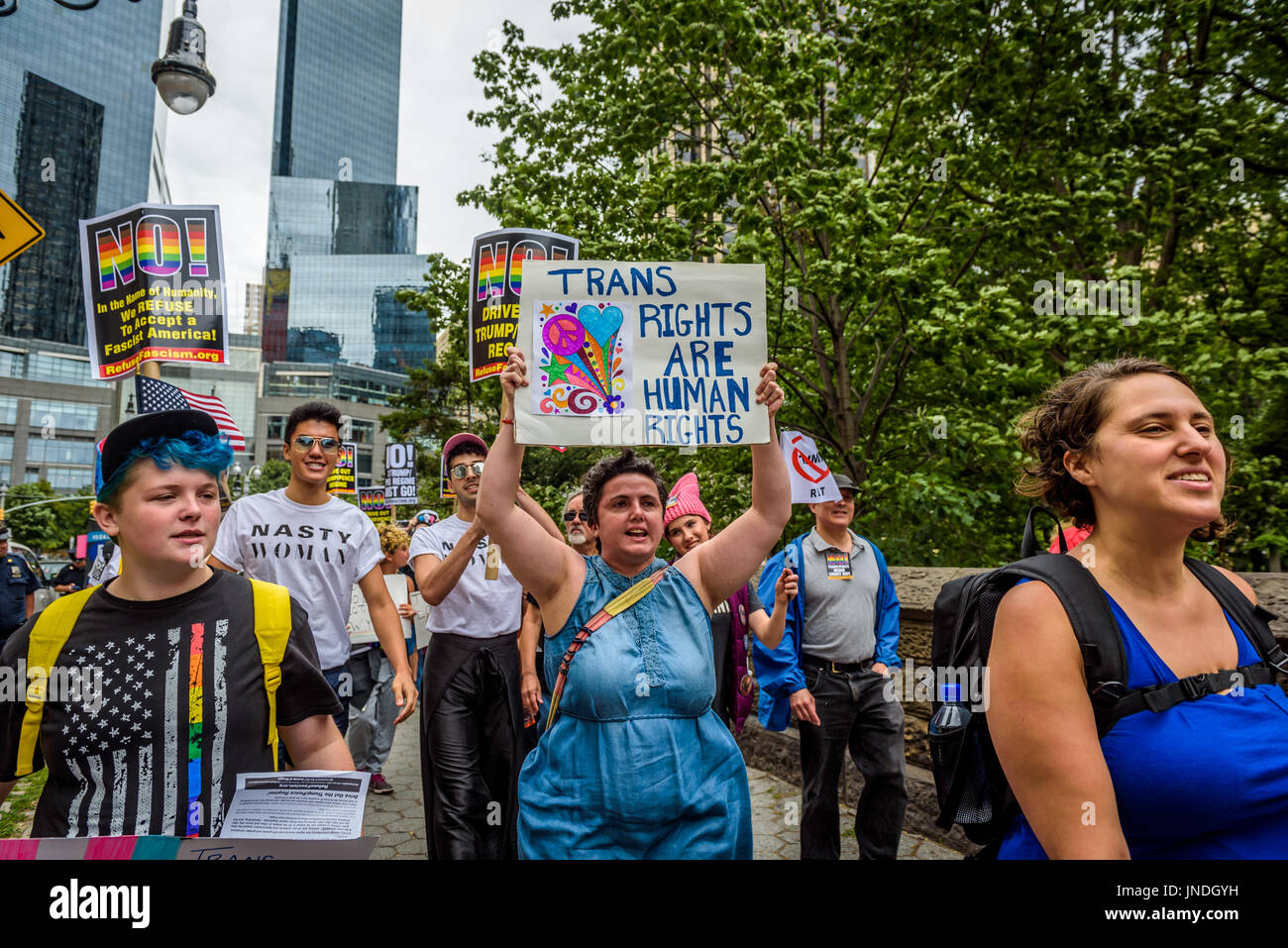 New York, United States. 29th July, 2017. A group of New Yorkers gathered at Columbus Circle across the Trump International Stock Photo