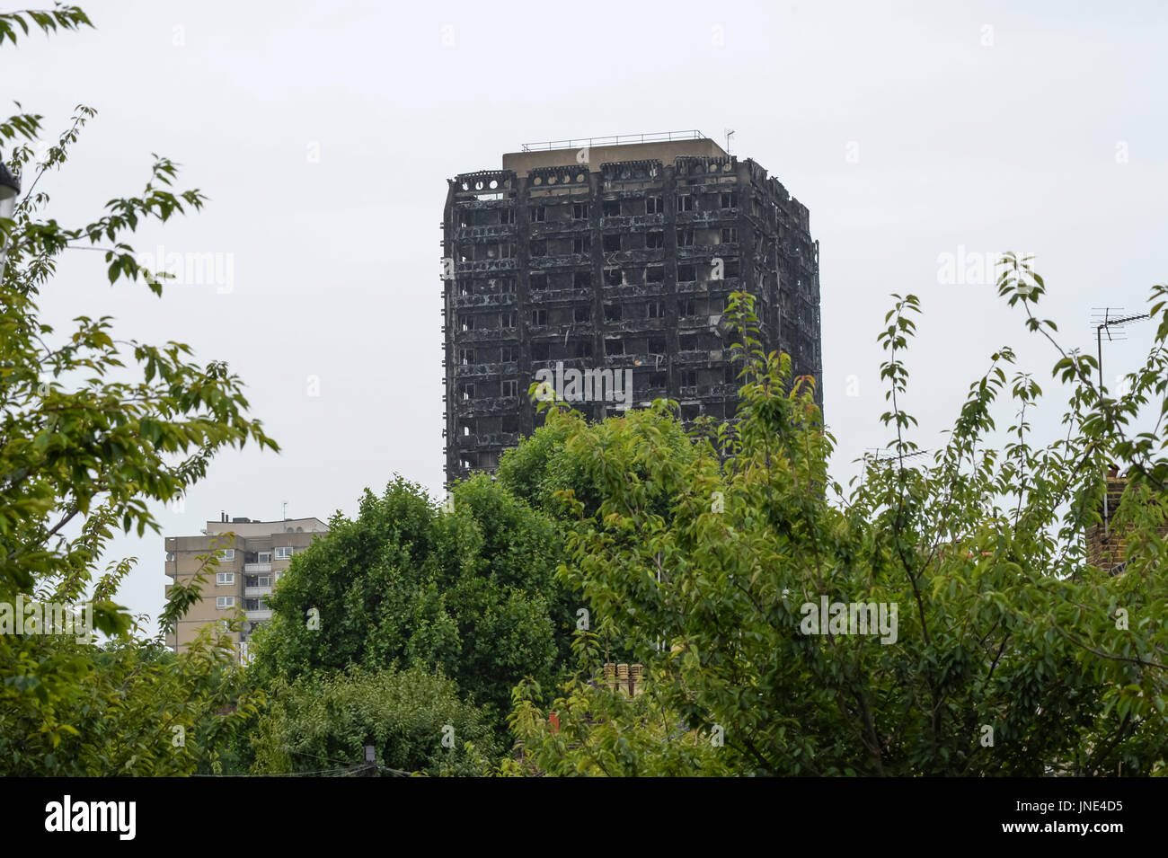 Grenfell Tower burnt remains. - Stock Image