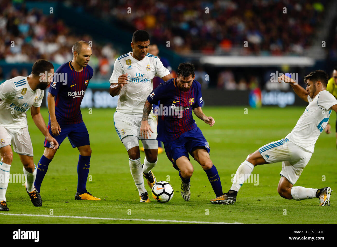 Lionel Andres Messi (10) FC Barcelona\'s player. Marco Asensio (20 ...